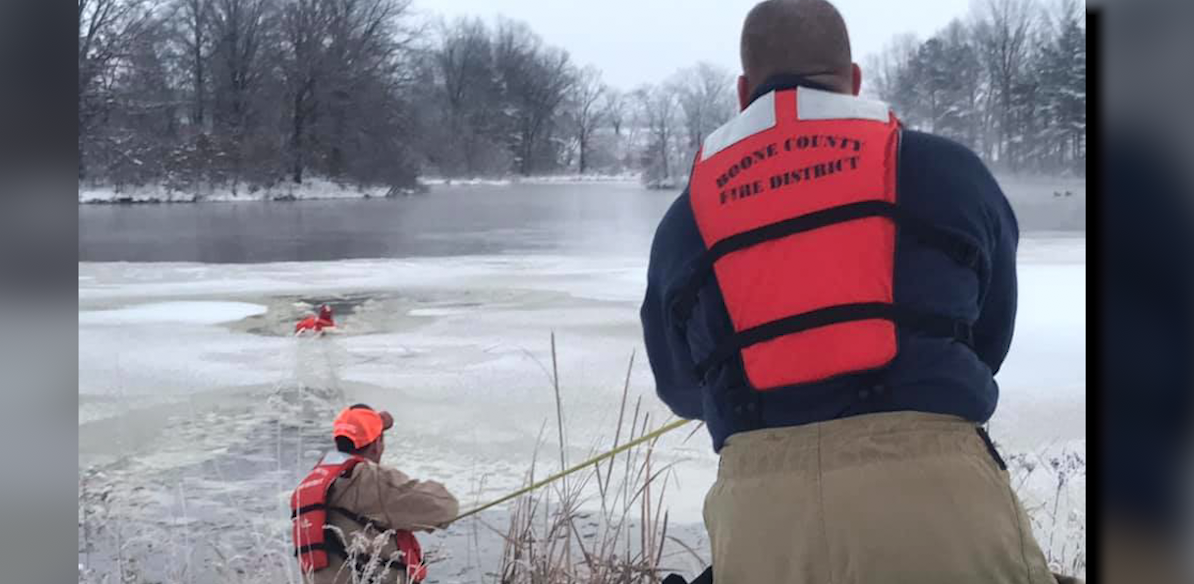 Firefighters work to pull a dog from a frozen pond off of Highway HH. Photo provided by the Boone County Fire Protection District
