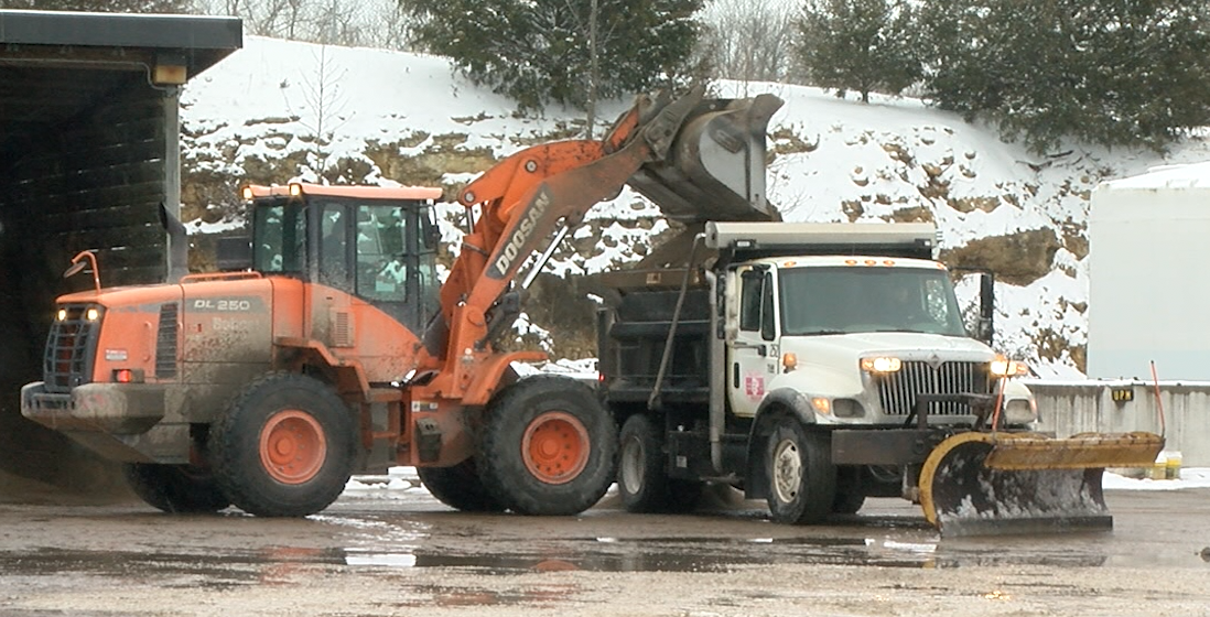 A Cole County Public Works truck refills on pretreatment materials during Wednesday's winter storm