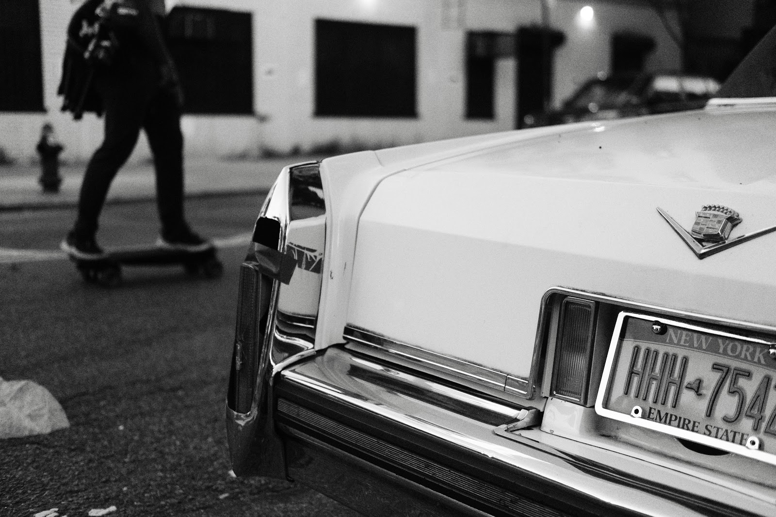 Photo of black and white cadillac