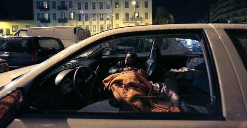 Edy, a man who has been homeless for several years, tries to sleep in his car in Nice