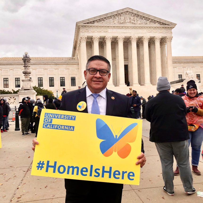 carbajal holds up a sign in support of dreamers.