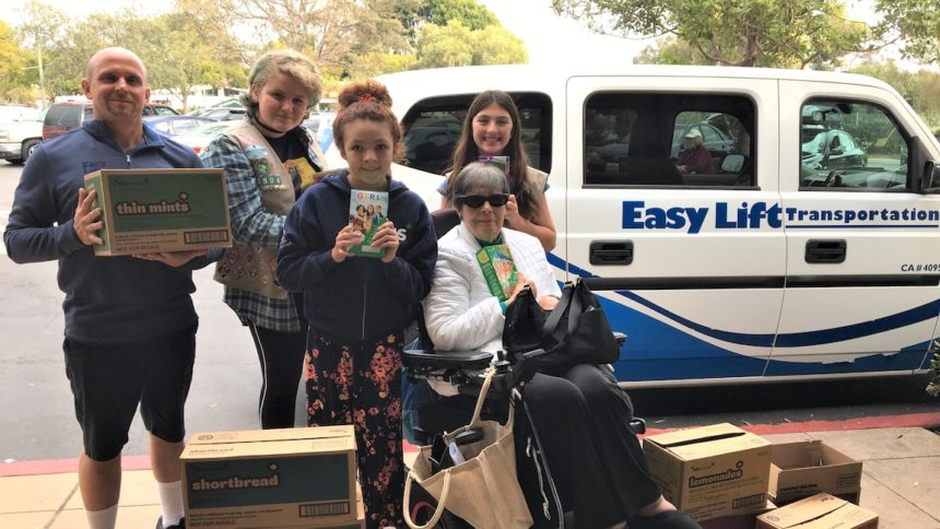 From left - Easy Lift Driver Jimmy Owens, Girl Scout Troop 55504 members Ruby Romo, Grace McElroy, and Maxine Nocker, with and passenger Marie Campbell[1] copy