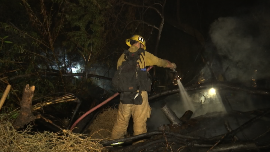 Firefighters put out encampment fire
