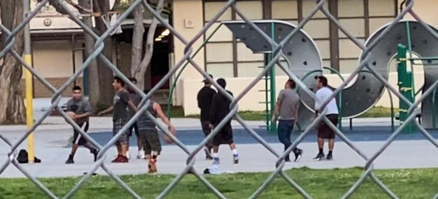 Youth playing basketball