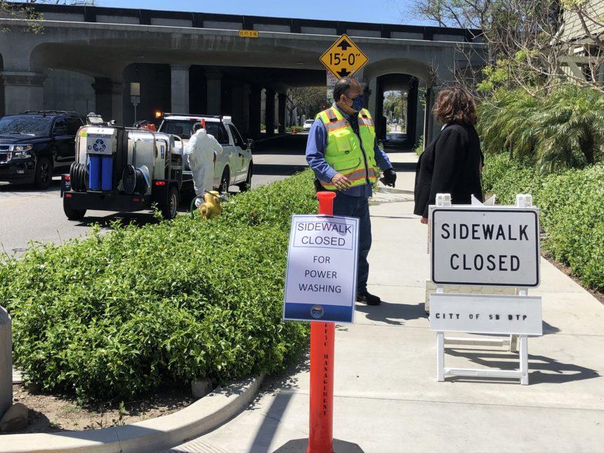 City closes sidewalk to power wash