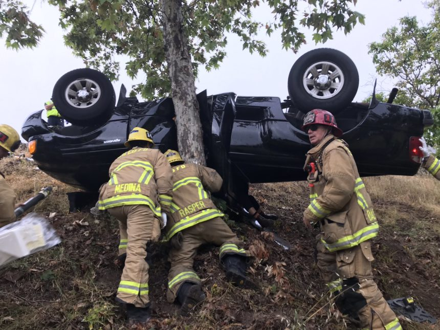 Truck rollover into embankment