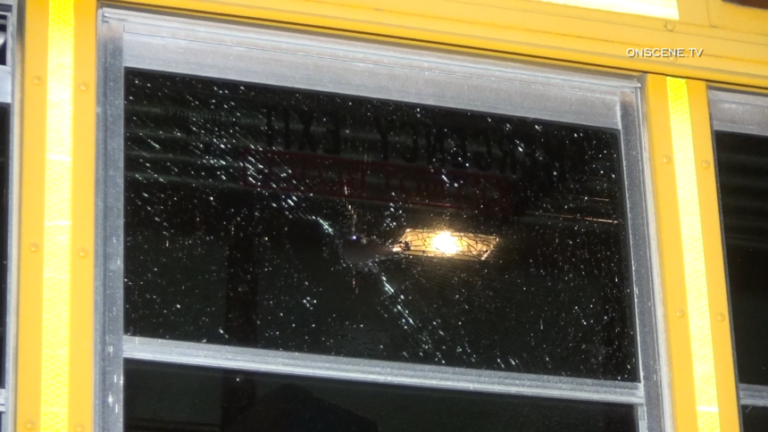 bus hit by projectile