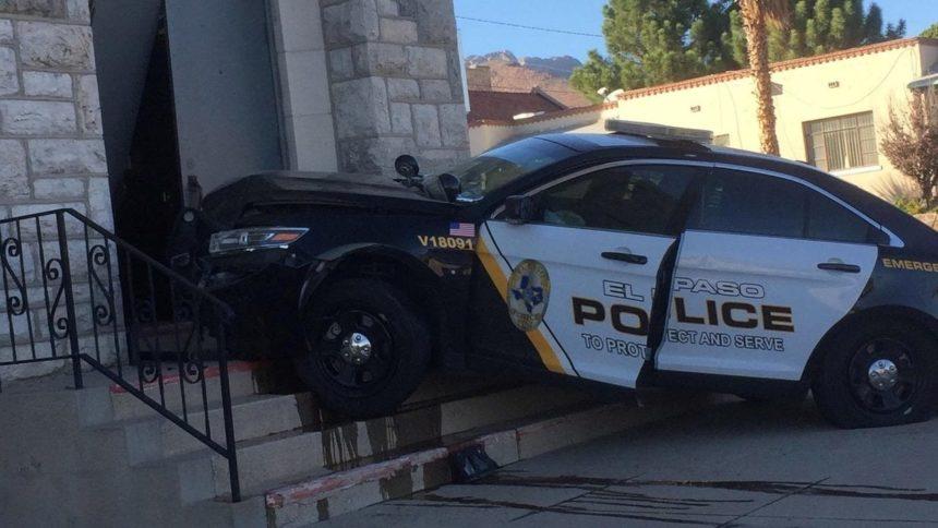 Police car crashes into church