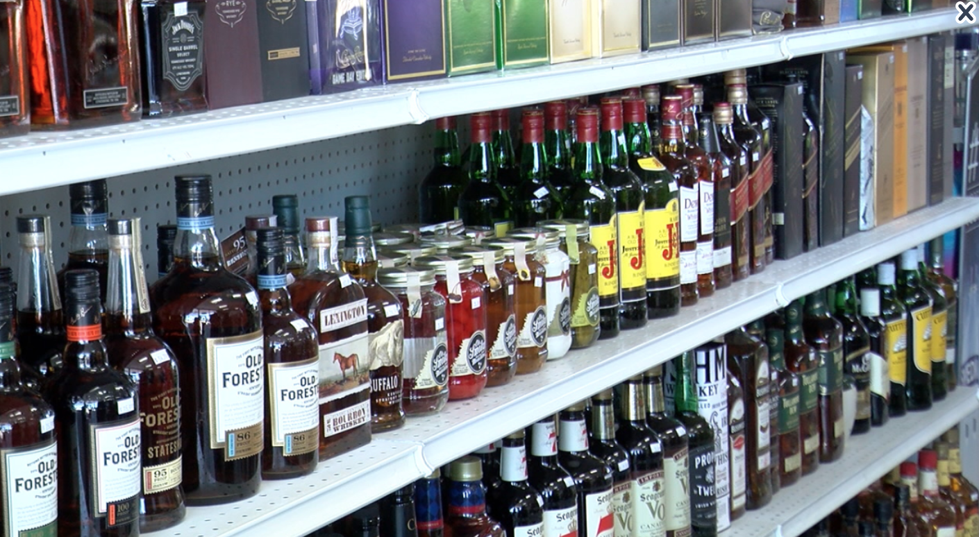 liquor bottles on store shelves