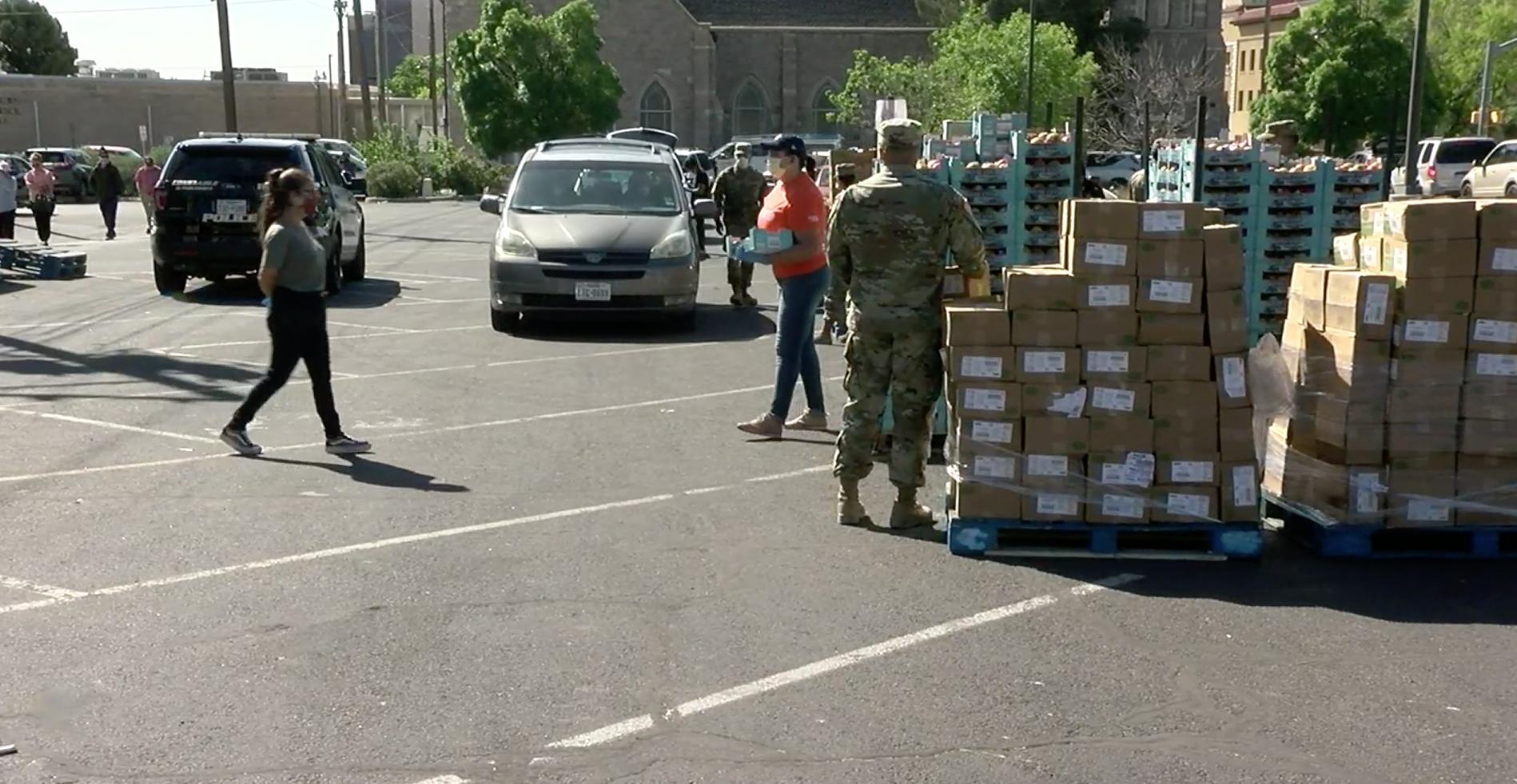 Volunteers distribute food boxes