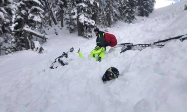 Snowmobiler's get caught in avalanche