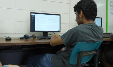 Student using Mimic Personal Finance Simulation