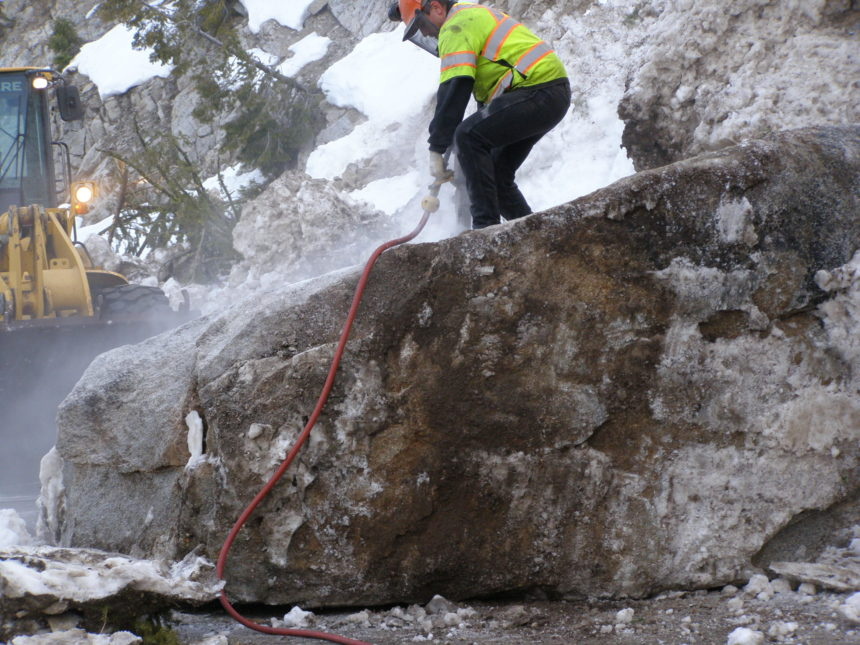 Highway-21-cleanup23_Operator-Dakota-Margan-of-Stanley-drills-holes-into-a-boulder-to-break-it-apart.-scaled.jpg April 9, 2020